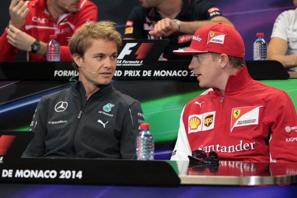 Nico Rosberg (GER) Mercedes AMG F1 and Kimi Raikkonen (FIN) Ferrari in the Press Conference. Formula One World Championship, Rd6, Monaco Grand Prix, Preparations, Monte-Carlo, Monaco, Wednesday 21 May 2014.