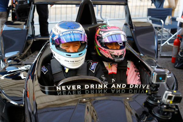 London, United Kingdom.  Wednesday 12 July 2017. Mika Hakkinen takes Sergio Perez, Force India, forn a ride. World Copyright: Steven Tee/LAT Images  ref: Digital Image _O3I9594