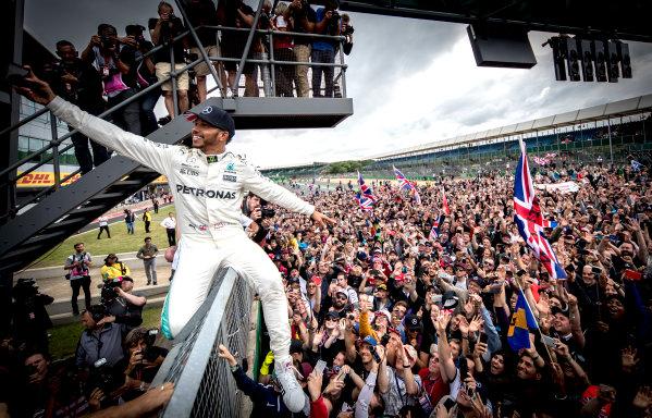 Silverstone, Northamptonshire, UK.  Sunday 16 July 2017. Lewis Hamilton, Mercedes AMG, 1st Position, celebrates victory with the British fans. World Copyright: Dunbar/LAT Images  ref: Digital Image _X4I8716
