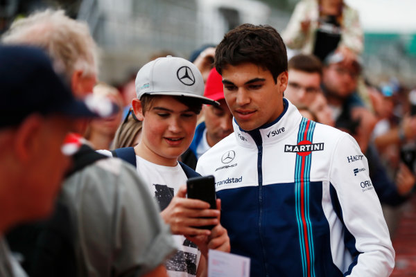 Silverstone, Northamptonshire, UK.  Thursday 13 July 2017. Lance Stroll, Williams Martini Racing, has his picture taken with a fan. World Copyright: Glenn Dunbar/LAT Images  ref: Digital Image _31I1986