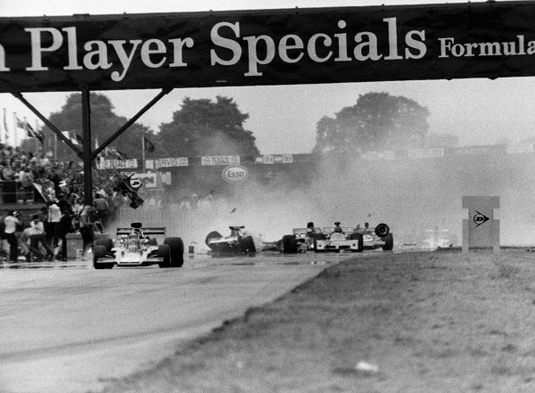 1973 British Grand Prix. Silverstone, England. 12-14 July 1973. Jody Scheckter (McLaren M23 Ford) causes a multiple pile-up at the end of lap 1. Amazingly only Andrea de Adamich was injured. World Copyright - LAT Photographic. ref: L73/1179/22
