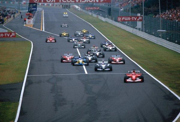 2003 Japanese Grand PrixSuzuka, Japan. 10th - 112th October 2003.Rubens Barrichello, Ferrari F2003 GA, leads Juan-Pablo Montoya, BMW Williams FW25, at the start of the race.World Copyright: Lorenzo Bellanca / LAT Photographic ref: 35mm Image 03JAP33