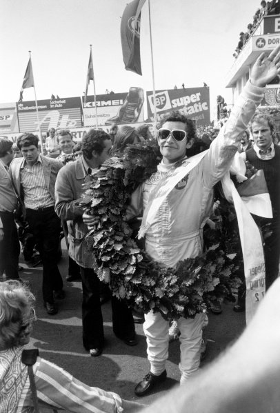 1972 German Grand Prix.Nurburgring, Germany. 30 July 1972.Jacky Ickx, Ferrari 312B2, 1st position, celebrates on the podium, portrait.World Copyright: LAT PhotographicRef: L72/1179/16A