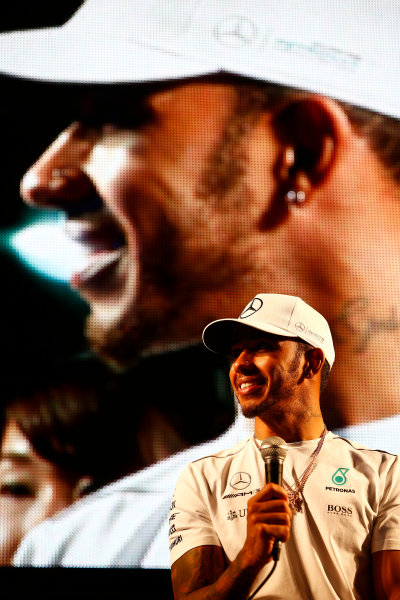 Suzuka Circuit, Japan. Saturday 7 October 2017. Lewis Hamilton, Mercedes AMG, addresses the fans from the F1 stage in the fanzone. World Copyright: Andrew Hone/LAT Images  ref: Digital Image _ONY7972