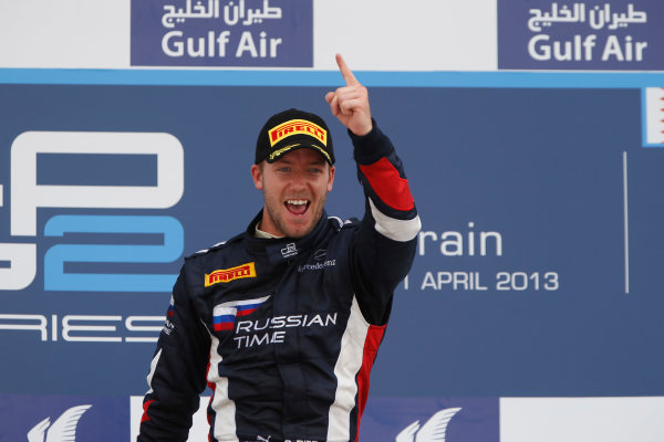 2013 GP2 Series. Round 2.  Bahrain International Circuit, Sakhir, Bahrain. 21st April.  Sunday Race.  Sam Bird (GBR, RUSSIAN TIME) celebrates his victory on the podium.  World Copyright: Glenn Dunbar/GP2 Series Media Service. Ref: _89P4313