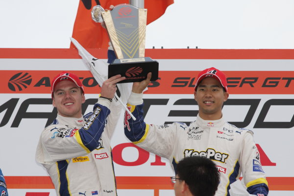2017 Japanese Super GT Series. Okayama, Japan. 8th - 9th April 2017. Rd 1. GT500 Winner Ryo Hirakawa & Nick Cassidy ( #37 KeePer TOM'S LC500 ) podium, portrait World Copyright: Yasushi Ishihara / LAT Images. Ref: 2017SGT_Rd1_005