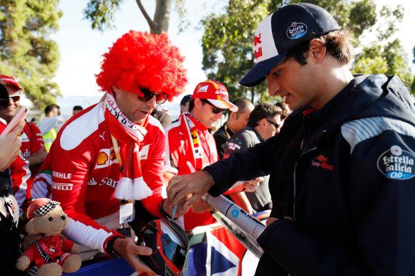 Albert Park, Melbourne, Australia. Wednesday 22 March 2017. Carlos Sainz Jr, Toro Rosso, signs autographs for fans. World Copyright: Sam Bloxham/LAT Images ref: Digital Image _W6I0165