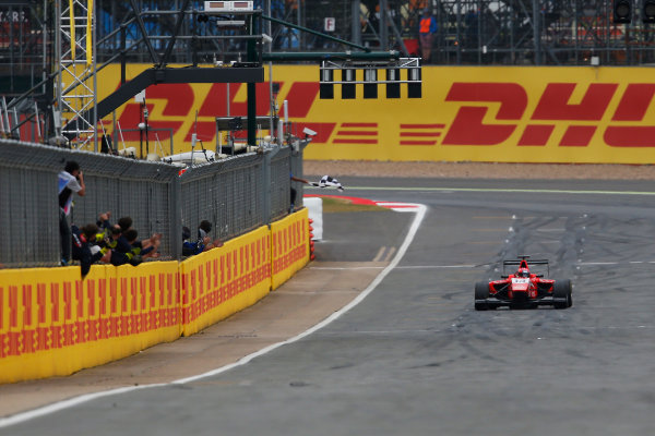 2015 GP3 Series Round 3. Silverstone, Northamptonshire, England. Sunday 5 July 2015. Kevin Ceccon (ITA, Arden International) takes the chequered flag. Photo: Zak Mauger/GP3 Series Media Service. ref: Digital Image _L0U5262