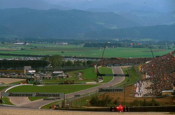 A1-Ring, Austria.19-21 September 1997.Eddie Irvine (Ferrari F310B) at the Remus Kurve, looking back down towards the Castrol Kurve.Ref-97 ITA 08.World  Copyright - LAT Photographic