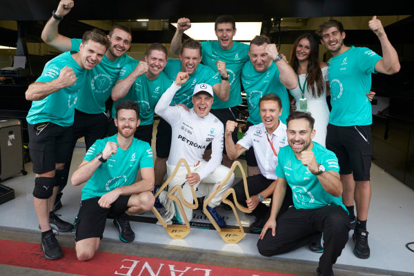 Red Bull Ring, Spielberg, Austria. Sunday 9 July 2017. Valtteri Bottas, Mercedes AMG, 1st Position, celebrates with his team. World Copyright: Steve Etherington/LAT Images ref: Digital Image SNE14792