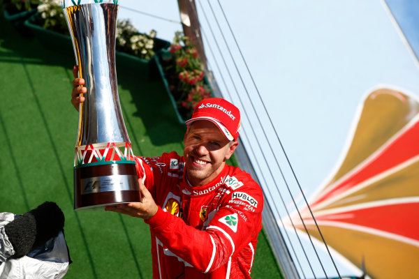 Hungaroring, Budapest, Hungary.  Sunday 30 July 2017. Sebastian Vettel, Ferrari, 1st Position, celebrates on the podium with his trophy. World Copyright: Andrew Hone/LAT Images  ref: Digital Image _ONZ1173
