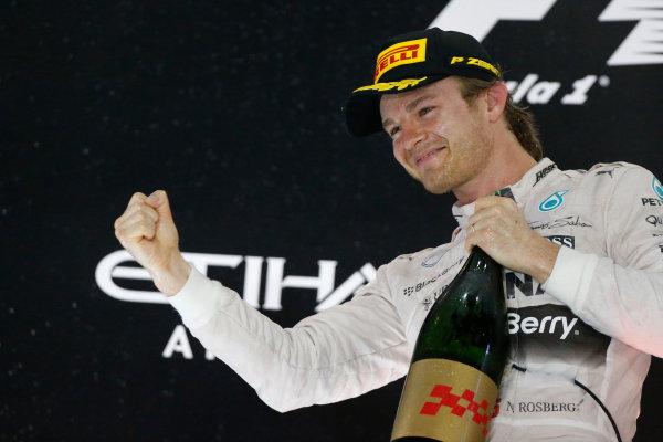 Yas Marina Circuit, Abu Dhabi, United Arab Emirates. Sunday 29 November 2015. Nico Rosberg, Mercedes AMG, 1st Position, celebrates victory on the podium. World Copyright: Andy Hone/LAT Photographic. ref: Digital Image _ONZ7450