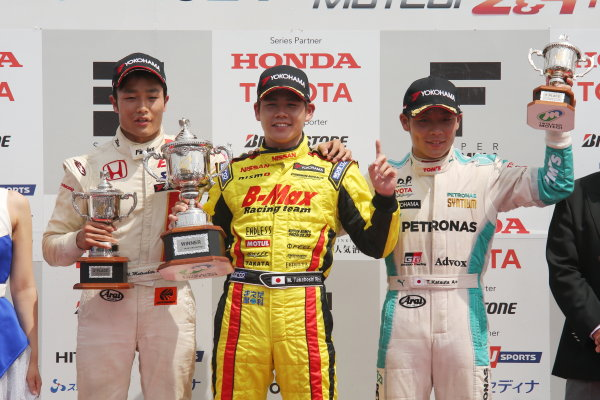 2014 All-Japan F3 Championship. Motegi, Japan. 23rd - 24th August 2014. Rd 5. Race 2 - Winner Mitsunori Takaboshi ( #22 B-MAX Racing Team with NDDP ) 2nd position Nobuharu Matsushita ( #7 HFDP RACING ) 3rd position Takamoto Katsuata ( #1 PETRONAS TEAM TOM'S ) podium, portrait. World Copyright: Yasushi Ishihara / LAT Photographic. Ref:  2014JF3_Rd10&11_016.JPG