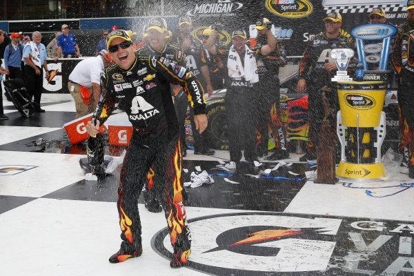 15-17 August, 2014, Brooklyn, Michigan USA Winner Jeff Gordon in Victory Lane with champagne ©2014, Michael L. Levitt LAT Photo USA