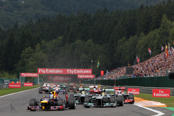 Sebastian Vettel (GER) Red Bull Racing RB9 overtakes Lewis Hamilton (GBR) Mercedes AMG F1 W04 to lead at the start of the race. Formula One World Championship, Rd11, Belgian Grand Prix, Race Day, Spa-Francorchamps, Belgium, Sunday 25 August 2013.  BEST IMAGE