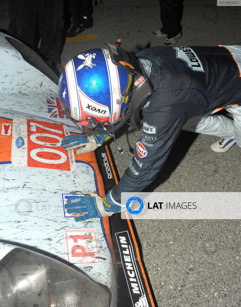 16-18 September, 2011, Monterey, California USA#007 Aston Martin Racing  wins overall as driver kiss nose of car.(c)2011,  Dan R. Boyd  LAT Photo USA