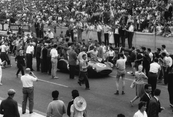 Le Mans, France. 20th - 21st June 1959 Roy Salvadori/Carroll Shelby (Aston Martin DBR1), 1st position, with Chief Designer, David Brown, sits on the car as they drive into parc ferme, action World Copyright: LAT PhotographicRef: 578 - 34A-35