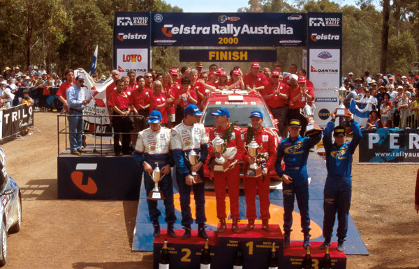 Rally Australia10th-12th November 2000Podium. 1st Tommi Makinen and Risto Mannisenmaki, 2nd Marcus Gronholm and Timo Rautiainen, 3rd Richard Burns and Robert Reid. Makinen would later be disqualified, prompting Gronholm to 1st.World Copyright © LAT Photographic