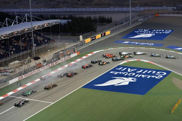 Lewis Hamilton (GBR) Mercedes AMG F1 W05 leads at the start of the race. Formula One World Championship, Rd3, Bahrain Grand Prix, Race, Bahrain International Circuit, Sakhir, Bahrain, Sunday 6 April 2014. BEST IMAGE