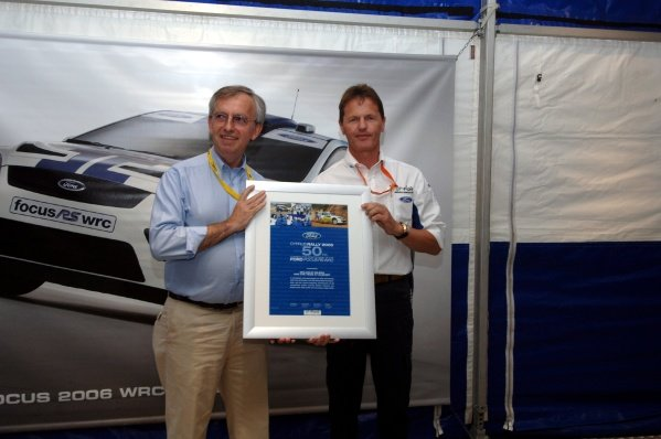 2005 FIA World Rally Championship, Rally of Turkey, June 2-5, 2005Kemer, Turkey.ShakedownIan Slater (GBR), Ford VP Communications and Public Affairs, presents Malcolm Wilson (GBR) with a plaque commemorating 50 consecutive points finishes for the Ford Focus WRC.Digital Image