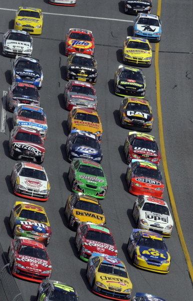 The pack race 3 wide around the front stretch.NASCAR Winston Cup, Rd1, Daytona 500, Daytona, Florida, USA, 16 February 2003.DIGITAL IMAGE