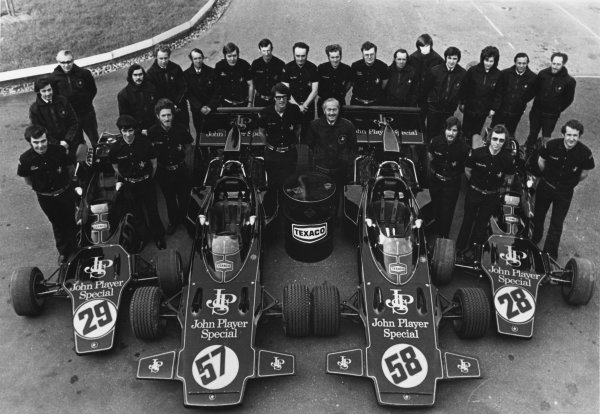Hethel, Norfolk, England.Colin Chapman and the whole JPS Lotus team and staff with the new cars, portrait.World Copyright: LAT Photographic.Ref:  B/W Print.