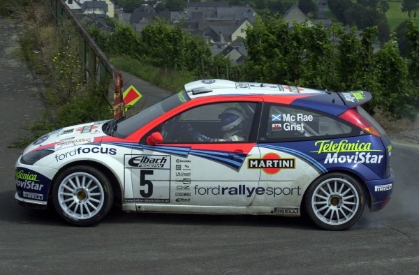 Colin McRae (GBR) Ford Focus RS WRC in action on Stage 5.