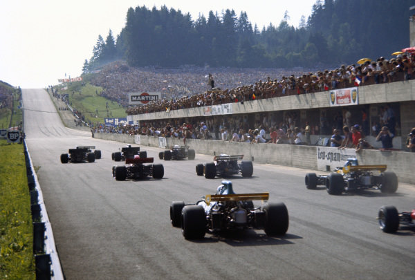 Rear view as the cars accelerate away at the start led by Jo Siffert's BRM P160.