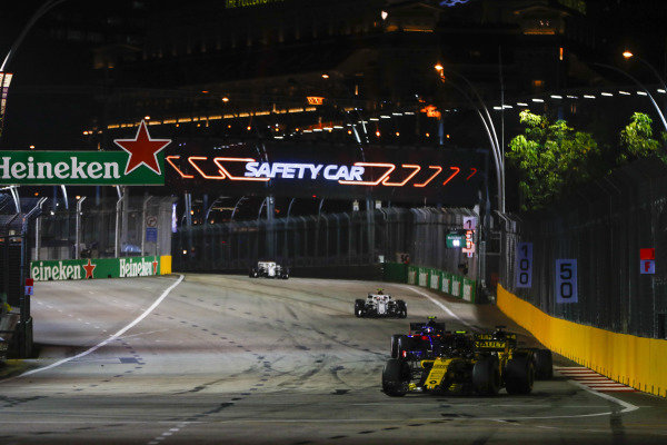 Carlos Sainz Jr., Renault Sport F1 Team R.S. 18, leads Nico Hulkenberg, Renault Sport F1 Team R.S. 18, and Pierre Gasly, Scuderia Toro Rosso STR13