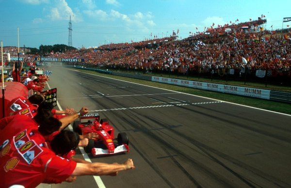 Michael Schumacher (GER) Ferrari F1 2001 crosses the finish line to win his fifty-first Grand Prix and his fourth World Championship Ð the second in a row for Ferrari.