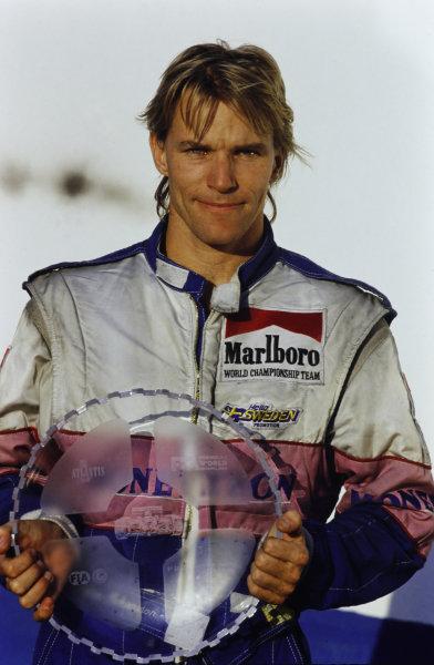 Stefan Johansson, Moneytron Onyx F1 Team, poses holding his third place trophy