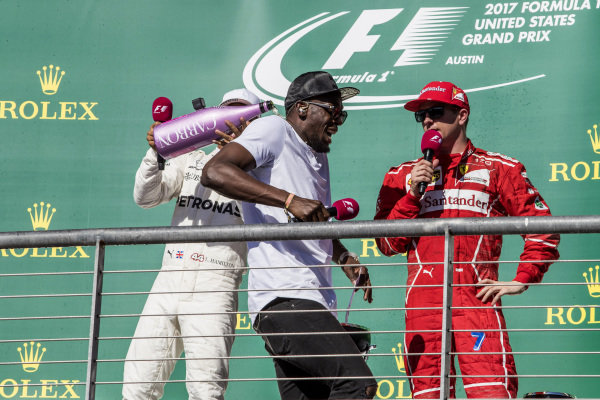 Race winner Lewis Hamilton (GBR) Mercedes AMG F1 celebrates on the podium with the champagne and Usain Bolt (JAM) alongside Kimi Raikkonen (FIN) Ferrari at Formula One World Championship, Rd17, United States Grand Prix, Race, Circuit of the Americas, Austin, Texas, USA, Sunday 22 October 2017.