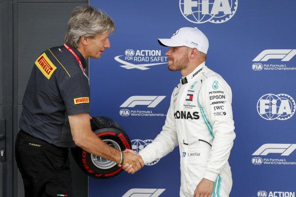 Roberto Boccafogli, Head of F.1 Communications presents the Pirelli Pole Position Award to Pole Sitter Valtteri Bottas, Mercedes AMG W10