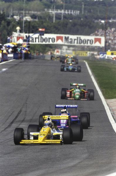 Luis Perez-Sala, Minardi M189 Ford, leads Stefan Johansson, Onyx ORE-1 Ford, as Alessandro Nannini, Benetton B189 Ford, follows behind.