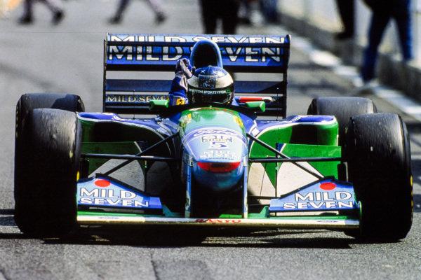 Michael Schumacher, Benetton B194 Ford, celebrates victory.