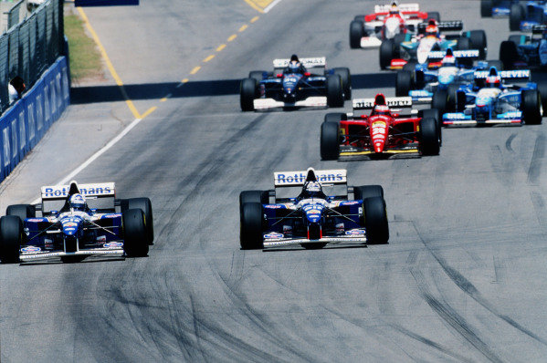 1995 Australian Grand Prix. Adelaide, Australia. 10-12 November 1995. Damon Hill leads teammate David Coulthard (both Williams FW17B Renault's) into the first corner at the start of the race. Ref-95 AUS 02. World Copyright - LAT Photographic