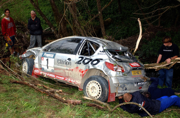 2002 World Rally Championship.Propecia Rally of New Zealand, Auckland, October 3rd-6th.Richard Burns damaged 206 after crashing out on stage 15.Photo: Ralph Hardwick/LAT