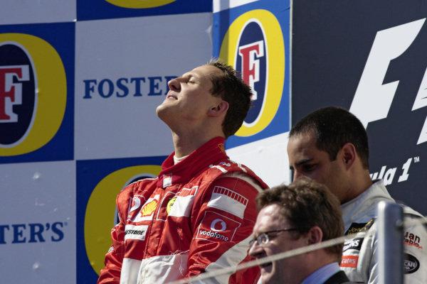 Winner Michael Schumacher soaks in the national anthem on the podium.