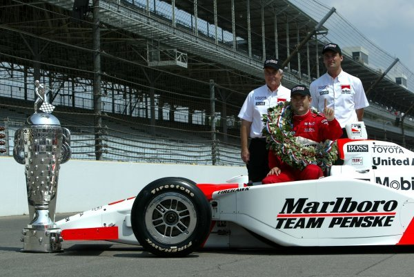 The Indy 500 winners with the famous trophy (L to R): Roger Penske (USA) Penske Team Owner; Gil de Ferran (BRA) Penske Racing G-Force Toyota winner; Tim Cindric (USA) Penske Racing President.Indy Racing League, Indianapolis 500, Indianapolis, USA, 26 May 2003.DIGITAL IMAGE