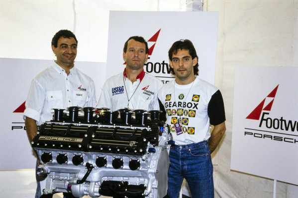 Michele Alboreto, Jackie Oliver, and Alex Caffi with the Porsche V12 engine they would use for the 1991 season.