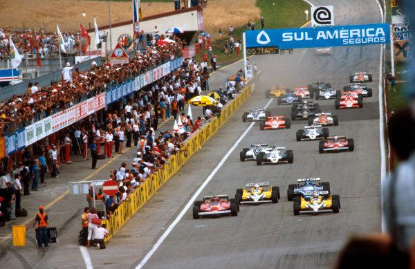 1981 Austrian Grand Prix.Osterreichring, Zeltweg, Austria.14-16 August 1981.Alain Prost (Renault RE30) leads Gilles Villeneuve (Ferrari 126CK) Rene Arnoux (Renault RE30) and Jacques Laffite (Talbot Ligier JS17 Matra) at the start.Ref-81 AUT 09.World Copyright - LAT Photographic