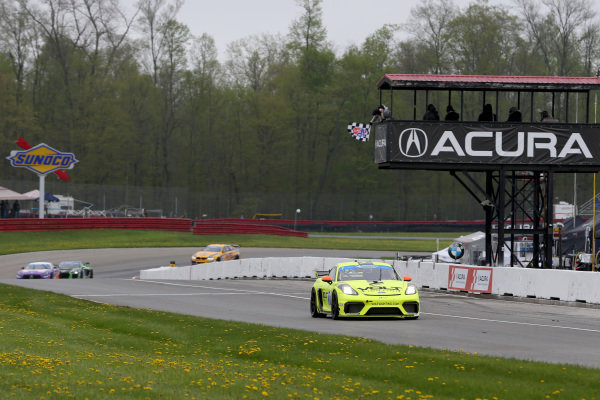 #7 Park Place Motorsports Porsche Cayman GT4 MR, GS: Alan Brynjolfsson, Trent Hindman crosses the finish line under the checkered flag for the win