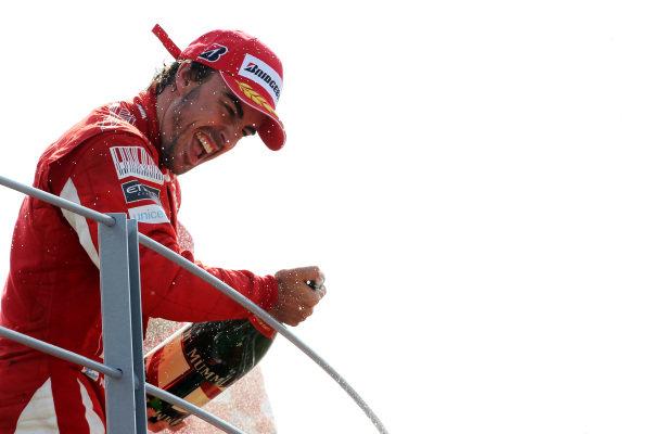 Race winner Fernando Alonso (ESP) Ferrari celebrates on the podium. Formula One World Championship, Rd 14, Italian Grand Prix, Race, Monza, Italy, Sunday 12 September 2010.  BEST IMAGE