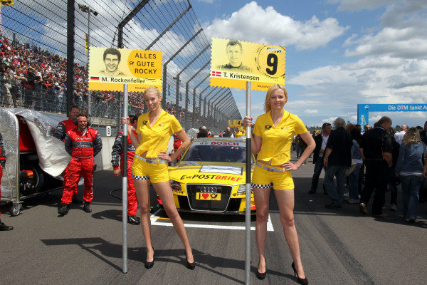 DTM Grid girls with a get well message for Mike Rockenfeller (GER) who is replaced for this round by Tom Kristensen (DEN) after he suffered a heavy crash at Le Mans.DTM, Rd4, Eurospeedway Lausitz, Germany, 18-19 June 2011.