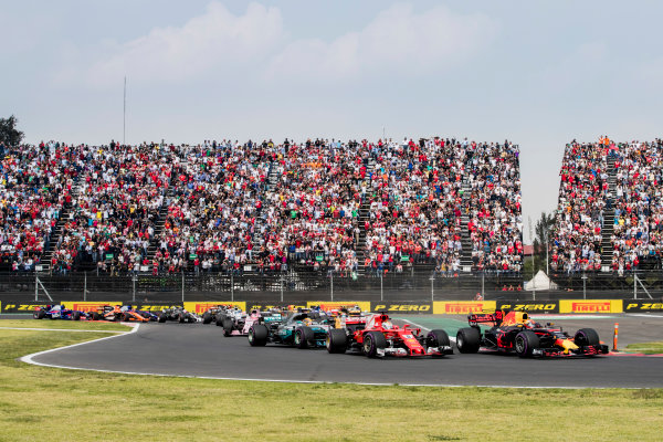 Autodromo Hermanos Rodriguez, Mexico City, Mexico. Sunday 29 October 2017. Max Verstappen, Red Bull Racing RB13 TAG Heuer leads Sebastian Vettel, Ferrari SF70H and Lewis Hamilton, Mercedes F1 W08 EQ Power+ into turn 2. World Copyright: Zak Mauger/LAT Images  ref: Digital Image _31I7480