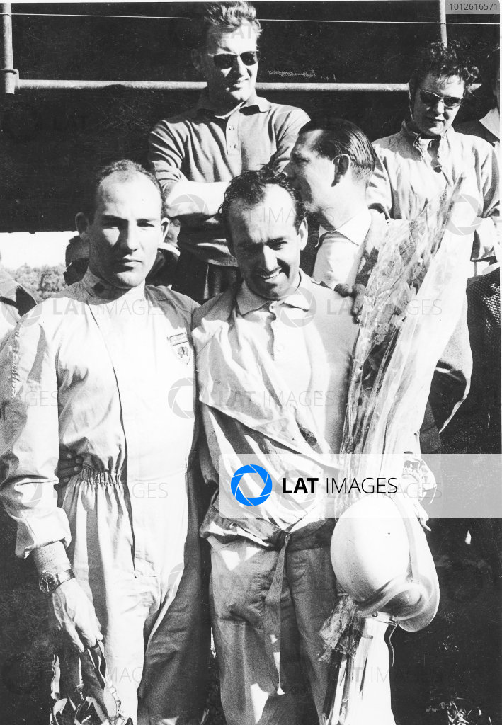Stirling Moss and Maurice Trintignant (right).
