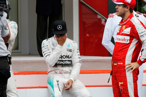 Monte Carlo, Monaco. Sunday 24 May 2015. Lewis Hamilton, Mercedes AMG, 3rd Position, takes a seat to reflect after the podium celebration. World Copyright: Steven Tee/LAT Photographic. ref: Digital Image _L4R3257