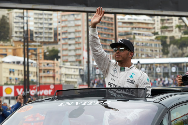 Monte Carlo, Monaco. Saturday 23 May 2015. Pole starter Lewis Hamilton, Mercedes AMG, is driven away from Parc Ferme after qualifying. World Copyright: Steve Etherington/LAT Photographic. ref: Digital Image SNE26598