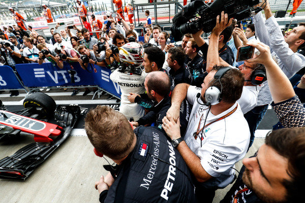 Lewis Hamilton, Mercedes AMG F1, 1st position, celebrates with his team on arrival in Parc Ferme