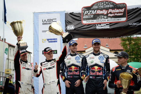 (L to R): Second placed Ott Tanak (EST) / Raigo Molder (EST), Drive DMACK World Rally Team WRC and Rally Winners Andreas Mikkelsen (NOR) / Anders Jaeger Synnevag (NOR), Volkswagen Motorsport II WRC and third placed Hayden Paddon (NZL) / John Kennard (NZL), Hyundai Motosport WRC celebrate on the podium with the trophies at FIA World Rally Championship, Rd7, Rally Poland, Day Three, Mikolajki, Poland, 3 July 2016.